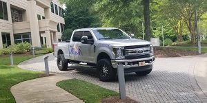 Alpharetta Pressure Washing Pickup Truck parked on a driveway in front of a condo