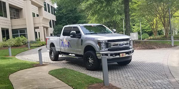 Alpharetta Pressure Washing truck in front of a building