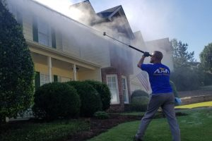 employee alpharetta pressure washing at work
