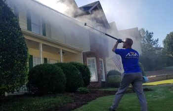 Man Pressure Washing Exterior of Home Alpharetta GA