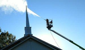 Alpharetta Pressure Washing worker cleaning chimney